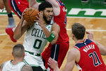 Boston Celtics forward Jayson Tatum (0) drives against Washington Wizards' Davis Bertans and center Moritz Wagner (21) in the second half of an NBA basketball game, Friday, Jan. 8, 2021, in Boston. (AP Photo/Elise Amendola)