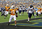 Tennessee's Tim Jordan (9) runs into the end zone past West Virginia's Shea Campbell (34) for a touchdown in the second half of an NCAA college football game in Charlotte, N.C., Saturday, Sept. 1, 2018. (AP Photo/Chuck Burton)