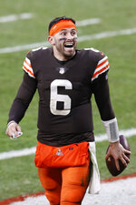 Cleveland Browns quarterback Baker Mayfield smiles as he walks off the field after an NFL football game against the Pittsburgh Steelers, Sunday, Jan. 3, 2021, in Cleveland. (AP Photo/Ron Schwane)