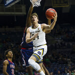 Notre Dame's Robby Carmody (24) drives to the basket during an NCAA college basketball game against Howard Tuesday, Nov. 12, 2019 at Purcell Pavilion in South Bend, Ind. (Michael Caterina/South Bend Tribune via AP)
