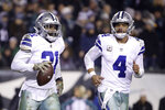 FILE - In this Nov. 11, 2018, file photo, Dallas Cowboys running back Ezekiel Elliott, left, celebrates after catching a touchdown pass from quarterback Dak Prescott (4) during the second half of an NFL football game against the Philadelphia Eagles, in Philadelphia. Prescott has his backfield mate back now that Ezekiel Elliott's holdout is over. (AP Photo/Matt Rourke, File)