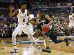 Michigan State guard Cassius Winston (5) drives past Duke forward Cam Reddish (2) during the first half of an NCAA men's East Regional final college basketball game in Washington, Sunday, March 31, 2019. (AP Photo/Alex Brandon)