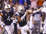Virginia linebacker Charles Snowden (11) runs in front of Virginia linebacker Jordan Mack (4) as he celebrates a defensive stop during the fourth quarter of an NCAA college football game against Old Dominion in Charlottesville, Va., Saturday, Sept. 21, 2019. (AP Photo/Andrew Shurtleff)