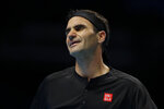 Roger Federer of Switzerland reacts after losing a point against Stefanos Tsitsipas of Greece during their ATP World Tour Finals semifinal tennis match at the O2 Arena in London, Saturday, Nov. 16, 2019. (AP Photo/Kirsty Wigglesworth)