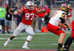 FILE - In this Oct. 7, 2017, file photo, Ohio State defensive end Nick Bosa rushes in against Maryland during an NCAA college football game Saturday, in Columbus, Ohio. Bosa's college football career is over. The injured All-American defensive end intends to withdraw from Ohio State to spend time rehabilitating and training for an NFL career. He is expected to be a first-round draft pick. No. 2 Ohio State made the announcement on Tuesday, Oct. 16, 2018. (AP Photo/Jay LaPrete, File)