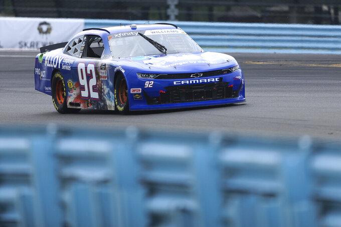 Josh Williams drives through Turn 1 in the NASCAR Xfinity Series auto race at Watkins Glen International in Watkins Glen, N.Y., on Saturday, Aug. 7, 2021. (AP Photo/Joshua Bessex)