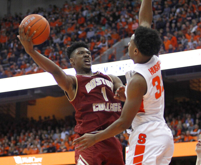 Boston College's Jarius Hamilton, left, shoots against Syracuse's Elijah Hughes, right, during the second half of an NCAA college basketball game in Syracuse, N.Y., Saturday, Feb. 9, 2019. Syracuse won 67-56. (AP Photo/Nick Lisi)