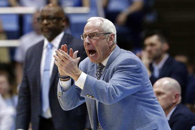 North Carolina head coach Roy Williams reacts during the second half of an NCAA college basketball game against North Carolina State in Chapel Hill, N.C., Tuesday, Feb. 25, 2020. (AP Photo/Gerry Broome)