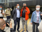 Pro-democracy activists Lee Cheuk-yan, second from right, and Yeng Sum, a former chairman of the Democratic Party, third from right, speak to media after being released on bail at a court in Hong Kong, Wednesday, April 7, 2021. Three veteran Hong Kong pro-democracy activists, including well-known publisher Jimmy Lai, have pleaded guilty to taking party in an unauthorized rally that resulted in violence between police and participants, media reported Wednesday. (AP Photo/Rafael Wober)