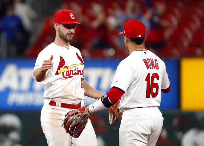 St. Louis Cardinals' Paul DeJong, left, celebrates with teammate Kolten Wong after a over the Philadelphia Phillies in a baseball game Monday, May 6, 2019, in St. Louis. (AP Photo/Jeff Roberson)