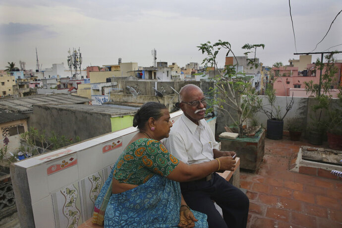 In this July 18, 2019, photo, retired Indian civil servant R. Devarajan with his wife Padmini sit at the terrace of their house equipped with rain water harvesting system in Chennai, India. For Devarajan and Padmini, Chennai's acute water shortage has reinforced the wisdom of their decision years ago to install a rainwater harvesting system in their three-story home. (AP Photo/Manish Swarup)