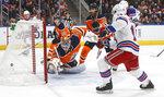New York Rangers' Ryan Strome (16) scores on Edmonton Oilers goalie Mikko Koskinen (19) during third period NHL hockey action in Edmonton, Alberta, Tuesday, Dec. 31, 2019. (Jason Franson/The Canadian Press via AP)