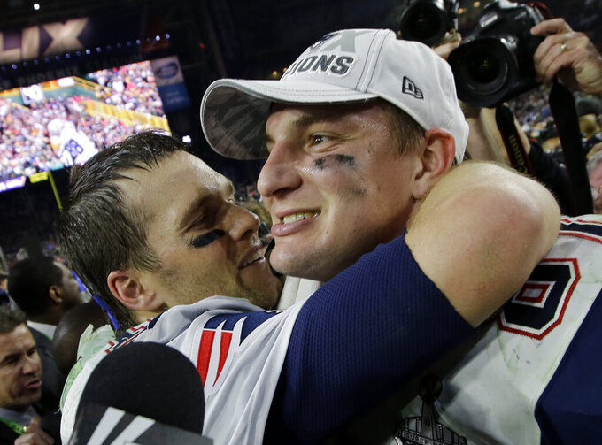 FILE - In this Feb. 1, 2015, file photo, New England Patriots quarterback Tom Brady, left, and Rob Gronkowski celebrate after they defeated the Seattle Seahawks in the NFL Super Bowl XLIX football game in Glendale, Ariz. Gronkowski is one of 218 players to appear in a Super Bowl as Brady's teammate, a number that will grow by more than 40 this week when Brady makes his record 10th trip to to the title game. (AP Photo/Kathy Willens, File)