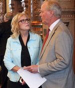In this Wednesday, Feb. 13, 2019 photo, Kansas state Sen. Mary Pilcher-Cook, left, R-Shawnee, confers with Sen. Gene Suellentrop, R-Wichta, before a Senate debate on a resolution condemning New York's new abortion law, at the Statehouse in Topeka, Kansas. Pilcher-Cook says Kansans lawmakers ought to make their opposition known because New York's law is