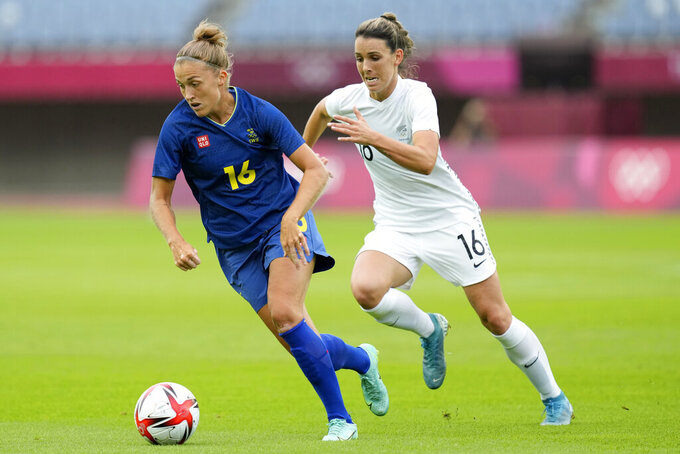Sweden's Filippa Angeldal, left, dribbles the ball against New Zealand's Emma Rolston during a women's soccer match between New Zealand and Sweden at the 2020 Summer Olympics, Tuesday, July 27, 2021, in Rifu, Japan. (AP Photo/Andre Penner)