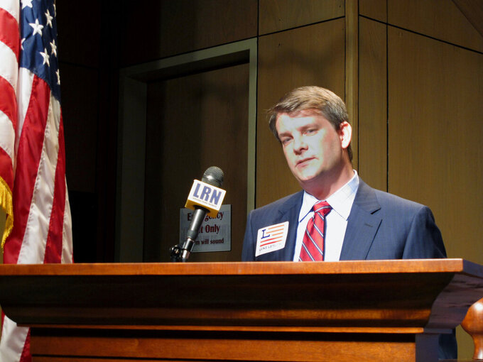 FILE - In this July 22, 2020 file photo, Luke Letlow, R-Start, chief of staff to exiting U.S. Rep. Ralph Abraham, speaks after signing up to run for Louisiana's 5th Congressional District in Baton Rouge, La.  The widow of Republican U.S. Rep.-elect Letlow is entering the race to fill the Louisiana congressional vacancy left by her husband's death from complications related to COVID-19. Julia Barnhill Letlow announced her campaign launch Thursday, Jan. 14, 2021. (AP Photo/Melinda Deslatte, File)