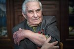 In this photo taken on Monday, Jan. 20, 2020, Yevgeny Kovalev, one of the Auschwitz concentration camp's survivors, shows the camp's identification number tattooed on his arm, during an interview with the Associated Press at his flat in Moscow, Russia. Kovalev was arrested by the Nazis as a teenager and sent to the Auschwitz death camp is still amazed 75 years later that he survived the ordeal. The 92-year-old was speaking ahead of the 75th anniversary on Monday, Jan. 27, 2020 of the camp's liberation in 1945.  (AP Photo/Alexander Zemlianichenko)