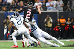 Tennessee Titans cornerback Malcolm Butler (21) and Tennessee Titans linebacker Harold Landry (58) sack Atlanta Falcons quarterback Matt Ryan (2) during the second half of an NFL football game, Sunday, Sept. 29, 2019, in Atlanta. (AP Photo/John Amis)