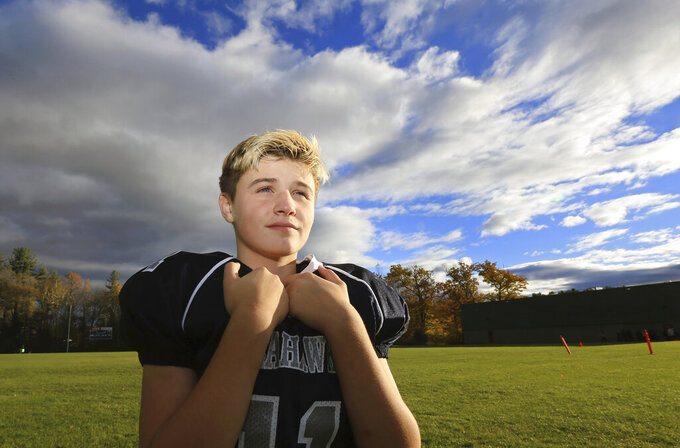 In this Oct. 30, 2018 photo, Dejah Rondeau, quarterback on the Exeter, N.H., Seahawks youth football team, poses on a field in Exeter, N.H. Rondeau,, 11, a seventh-grade girl from New Hampshire who was bullied for playing quarterback on a youth football team, is going to the Super Bowl courtesy of the New England Patriots. (Ioanna Raptis/Portsmouth Herald via AP)