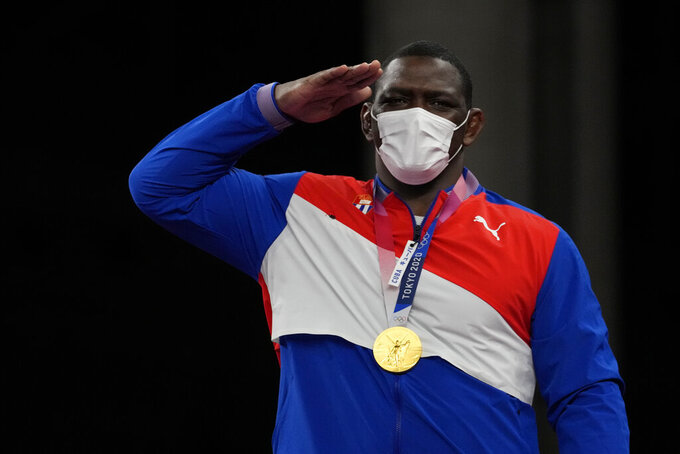 Gold medalist, Cuba's Mijain Lopez Nunez celebrates during the medal ceremony for the men's 130kg Greco-Roman wrestling final match at the 2020 Summer Olympics, Monday, Aug. 2, 2021, in Chiba, Japan. (AP Photo/Aaron Favila)