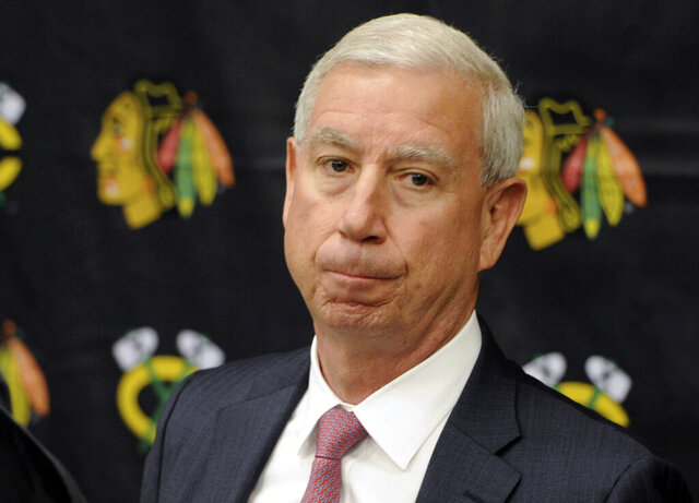 FILE - In this Sept. 17, 2015, file photo, Chicago Blackhawks president John McDonough gets ready to answer questions during a media availability in South Bend, Ind. The Blackhawks have fired team president McDonough, ending a wildly successful run that included three Stanley Cup championships. The surprising move comes with the NHL season on pause because of the coronavirus pandemic. (AP Photo/Joe Raymond, File)