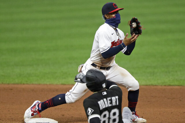 Cleveland Indians' Francisco Lindor gets Chicago White Sox's Luis Robert at second base in the seventh inning in the second baseball game of a doubleheader, Tuesday, July 28, 2020, in Cleveland. (AP Photo/Tony Dejak)