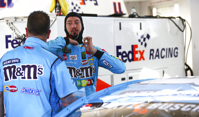Kyle Busch, right, waits to begin qualifying for a NASCAR Cup Series auto race at Las Vegas Motor Speedway, Friday, Sept. 13, 2019, in Las Vegas. (Chase Stevens/Las Vegas Review-Journal via AP)