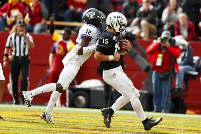 Iowa State quarterback Brock Purdy (15) scores on a 10-yard touchdown run ahead of TCU cornerback Jeff Gladney, left, in the second half of an NCAA college football game, Saturday, Oct. 5, 2019, in Ames, Iowa. Iowa State won 49-24. (AP Photo/Charlie Neibergall)