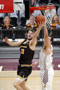 Valparaiso's Ben Krikke (23) scores past Loyola Chicago's Cameron Krutwig during the first half of an NCAA college basketball game Wednesday, Feb. 17, 2021, in Chicago. (AP Photo/Charles Rex Arbogast)