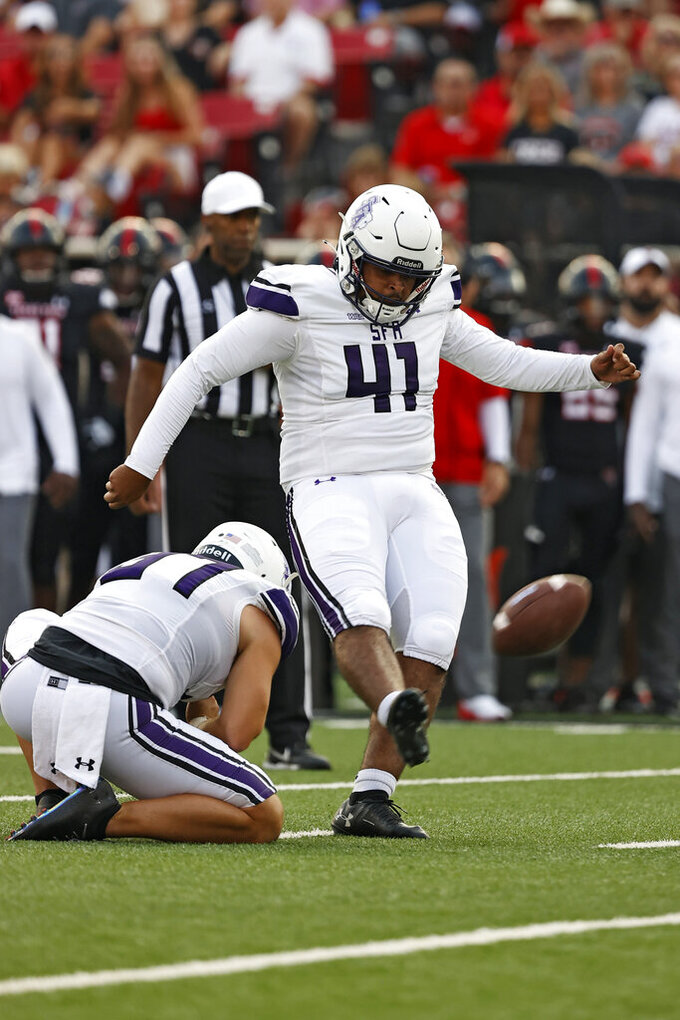 Stephen F. Austin's Chris Campos (41) kicks a field goal during the first half of an NCAA college football game against Texas Tech, Saturday, Sept. 11, 2021, in Lubbock, Texas. (AP Photo/Brad Tollefson)