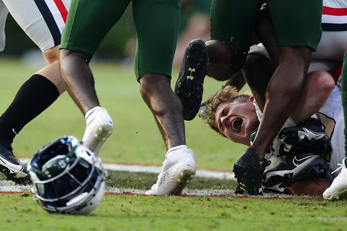 UAB linebacker Will Conner (45) reacts after losing his helmet making a tackle during the second half of an NCAA college football game against Georgia, Saturday, Sept. 11, 2021, in Athens, Ga. (AP Photo/John Bazemore)