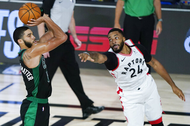 Boston Celtics' Jayson Tatum shoots as Toronto Raptors' Norman Powell (24) defends during the second half of an NBA basketball conference semifinal playoff game Sunday, Aug. 30, 2020, in Lake Buena Vista, Fla. (AP Photo/Ashley Landis)