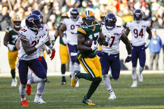Green Bay Packers' Davante Adams runs after catching a pass during the second half of an NFL football game against the Chicago Bears Sunday, Dec. 15, 2019, in Green Bay, Wis. (AP Photo/Matt Ludtke)