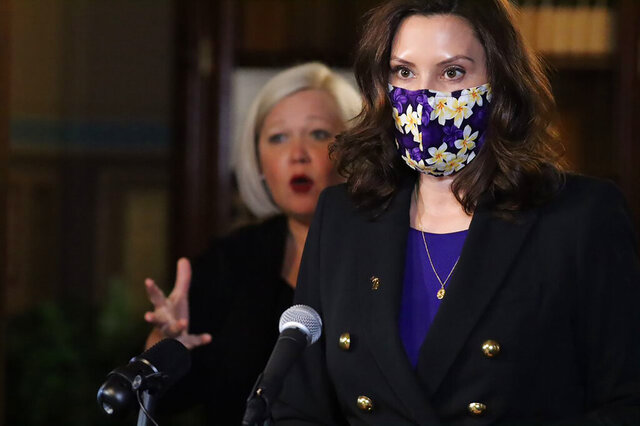 In a photo provided by the Michigan Office of the Governor, Gov. Gretchen Whitmer addresses the state in Lansing, Mich., Wednesday, Jan. 13, 2021. Gov. Whitmer's administration said Wednesday that Michigan restaurants should be able to reopen for indoor dining on Feb. 1, 2021, if coronavirus cases and hospitalizations remain stable, extending a two-month ban by an additional two weeks while letting non-contact sports resume this weekend. (Michigan Office of the Governor via AP)