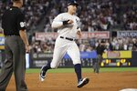 New York Yankees' Aaron Judge, center, reaches third base on a double by Aaron Hicks during the fifth inning of a baseball game against the Toronto Blue Jays, Friday, July 12, 2019, in New York. (AP Photo/Frank Franklin II)