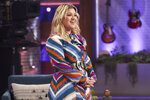 This image released by NBC shows Kelly Clarkson on the set of her syndicated talk show