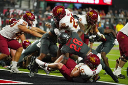 Iowa State running back Breece Hall (28) runs in for a touchdown against UNLV during the first half of an NCAA college football game Saturday, Sept. 18, 2021, in Las Vegas. (AP Photo/John Locher)