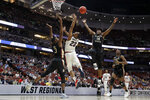 Florida State guard Terance Mann, right, vies for a rebound with Gonzaga guard Zach Norvell Jr., middle, and Florida State's Trent Forrest during the first half an NCAA men's college basketball tournament West Region semifinal Thursday, March 28, 2019, in Anaheim, Calif. (AP Photo/Jae C. Hong)