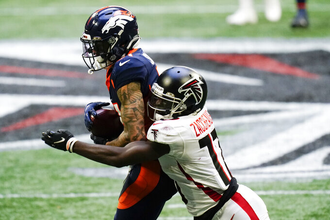 Denver Broncos free safety Justin Simmons (31) intercepts the ball behind Atlanta Falcons wide receiver Olamide Zaccheaus (17) during the second half of an NFL football game, Sunday, Nov. 8, 2020, in Atlanta.(AP Photo/Brynn Anderson)