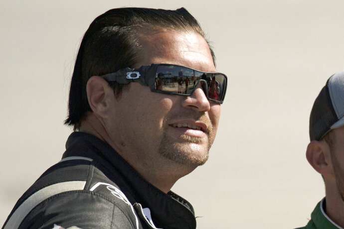 FILE - In this Oct. 5, 2019, file photo, driver B.J. McLeod, waits to get into their cars before qualifying for the NASCAR Xfinity Series auto race in Dover, Del. NASCAR will have another new team in 2021 — bringing the total to three new ownership groups in the Cup Series —  with the formation of Live Fast Motorsports. The team formally announced Friday, Nov. 20, 2020, is owned by drivers Matt Tifft and B.J. McLeod.  (AP Photo/Brien Aho, File)