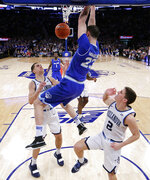 Seton Hall forward Sandro Mamukelashvili (23) dunks on Villanova guard Collin Gillespie (2) and forward Cole Swider during the first half of an NCAA college basketball game in the championship of the Big East Conference tournament, Saturday, March 16, 2019, in New York. (AP Photo/Julio Cortez)