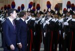 Italian Premier Giuseppe Conte, left, and French President, Emmanuel Macron review the honor guard during their meeting at Chigi Palace in Rome, Wednesday, Sept. 18, 2019. (Riccardo Antimiani/ANSA via AP)