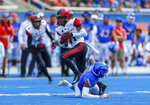 San Diego State wide receiver BJ Busbee, left, avoids the tackle attempt by Boise State safety Tyreque Jones, on the ground, in the first half of an NCAA college football game, Saturday, Oct. 6, 2018, in Boise, Idaho. (AP Photo/Steve Conner)