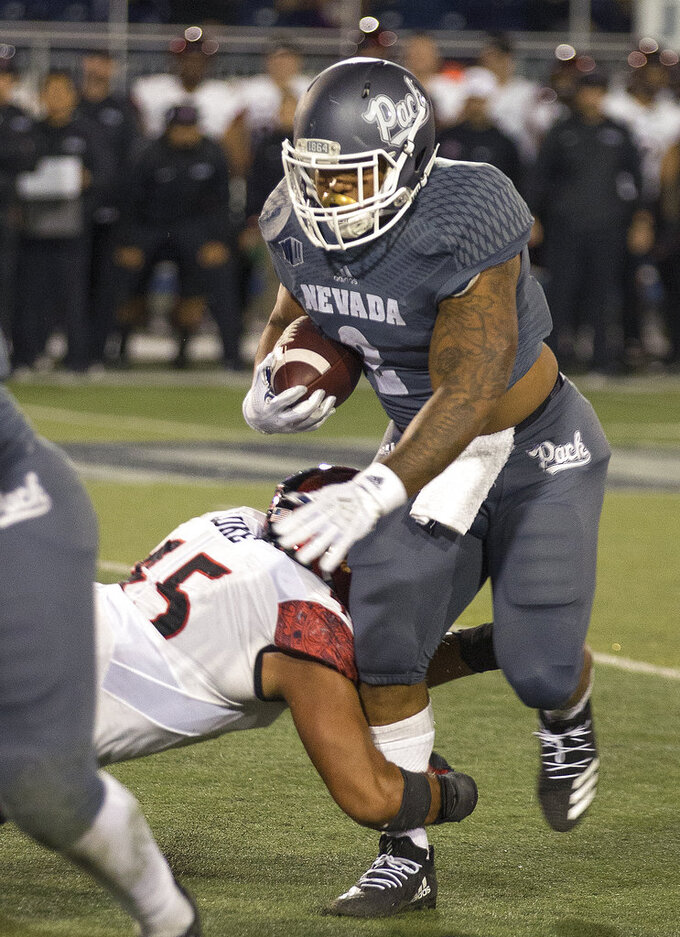 Nevada running back Devonte Lee (2) is hit by San Diego State's Anthony Lukein (45) the second half of an NCAA college football game in Reno, Nev., Saturday, Oct. 27, 2018. (AP Photo/Tom R. Smedes)