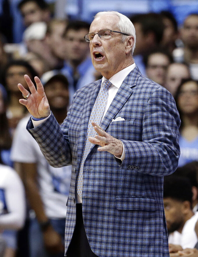 North Carolina head coach Roy Williams directs his team during the second half of an NCAA college basketball game against North Carolina State in Chapel Hill, N.C., Tuesday, Feb. 5, 2019. (AP Photo/Gerry Broome)