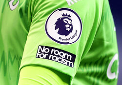 "FILE - This Sunday, Sept. 13, 2020 file photo shows the ""No Room For Racism"" logo on the shirt of Everton's goalkeeper Jordan Pickford during the English Premier League soccer match between Tottenham Hotspur and Everton at the Tottenham Hotspur Stadium in London. Four days of silence across Twitter, Facebook and Instagram by soccer leagues, clubs and players in England was beginning on Friday April 30, 2021, in a protest against racist abuse that has been adopted more widely. (Cath Ivill/Pool via AP, File)"