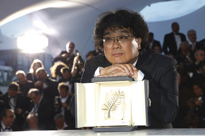 Director Bong Joon-ho poses with the Palme d'Or award for the film 'Parasite' during a photo call following the awards ceremony at the 72nd international film festival, Cannes, southern France, Saturday, May 25, 2019. (Photo by Vianney Le Caer/Invision/AP)