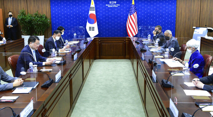 In this photo provided by South Korea Foreign Ministry, U.S. Deputy Secretary of State Wendy Sherman, right, holds talks with South Korean First Vice Foreign Minister Choi Jong Kun, left, during their meeting at the Foreign Ministry in Seoul, South Korea, Friday, July 23, 2021. Top U.S. and South Korean officials agreed Thursday to try to convince North Korea to return to talks on its nuclear program, which Pyongyang has insisted it won't do in protest of what it calls U.S. hostility. (South Korea Foreign Ministry via AP)