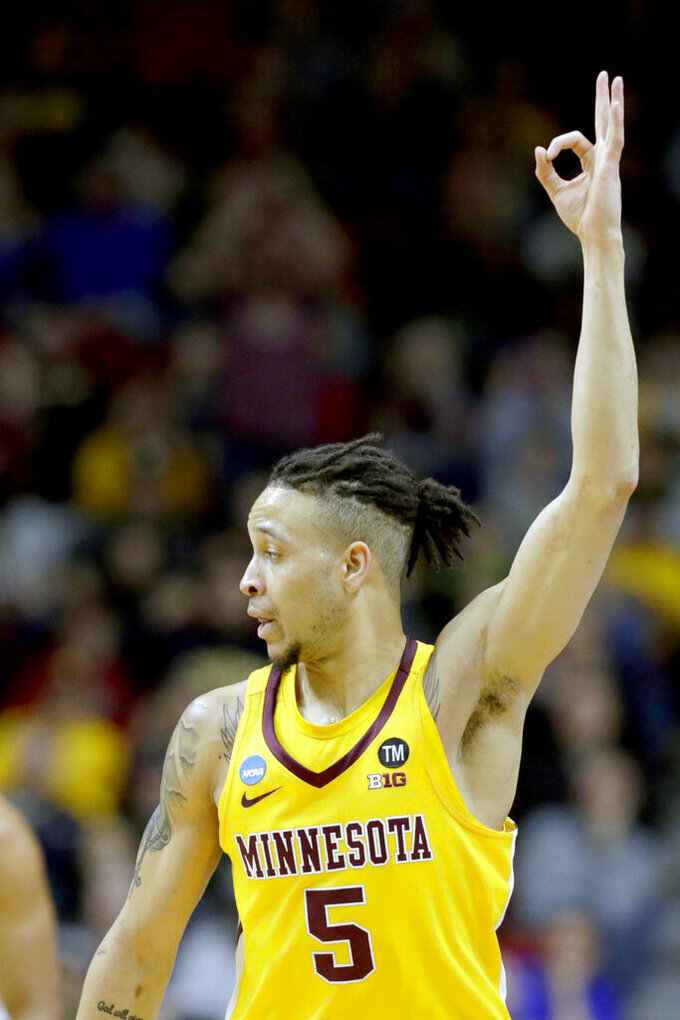 Minnesota's Amir Coffey (5) celebrates a three point basket during the first half of a first round men's college basketball game against Louisville in the NCAA Tournament, in Des Moines, Iowa, Thursday, March 21, 2019. (AP Photo/Nati Harnik)