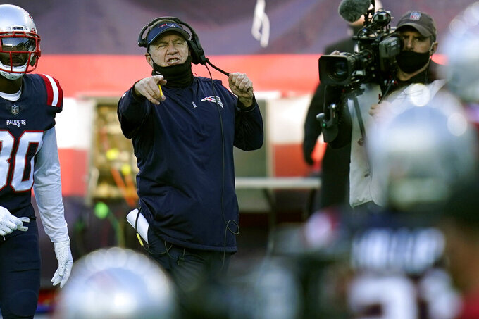 New England Patriots head coach Bill Belichick gestures from the sideline in the first half of an NFL football game against the Arizona Cardinals, Sunday, Nov. 29, 2020, in Foxborough, Mass. (AP Photo/Charles Krupa)